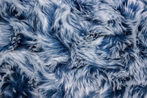 青い毛皮テクスチャのクローズアップ。滑らかなふわふわと柔らかさの背景