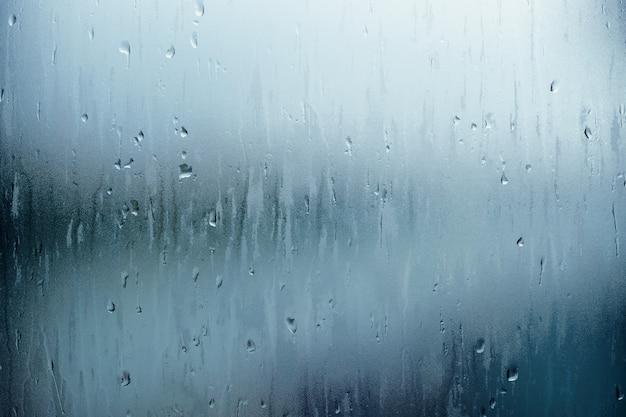 Фон текстуры капли воды, дождь падает с неба и капли на стеклянной крыше