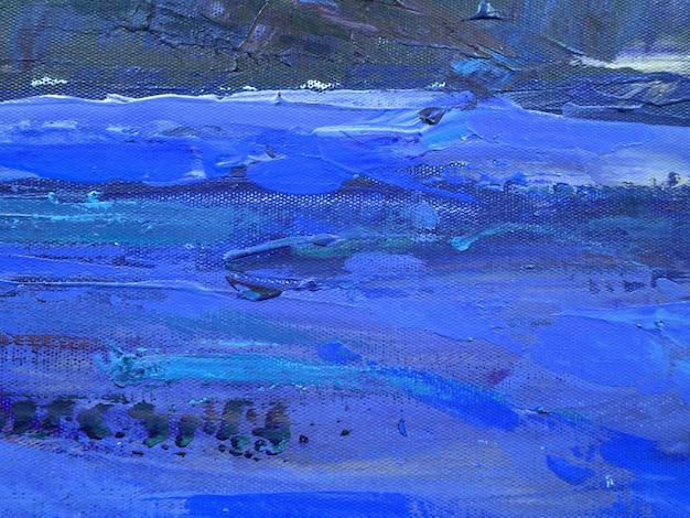 濃い青の色のブラシストロークの抽象芸術の背景。