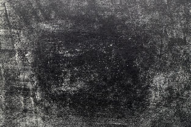 ブラックボードの背景にグランジホワイトカラーチョークテクスチャ
