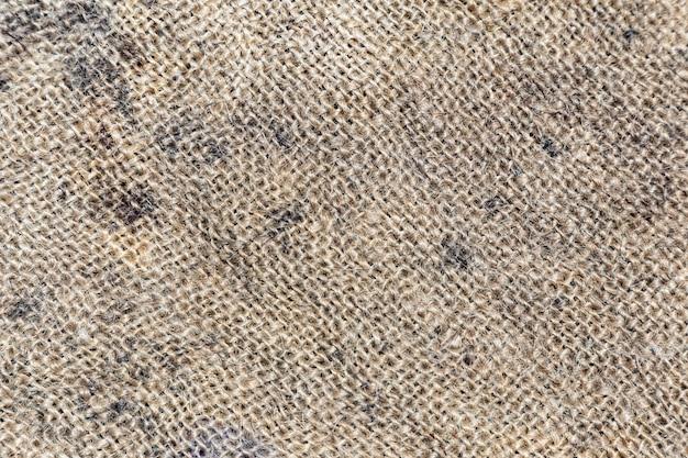 黄麻布のテクスチャまたは黄麻布の背景。ダークカントリー解任黄麻布キャンバス。