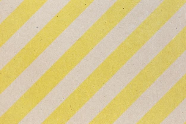 ビジネスコミュニケーションと教育の概念設計のための黄色と茶色のリサイクル紙の背景。