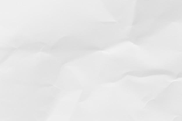 ビジネスのコミュニケーションと教育の概念設計のための白い紙を丸めてリサイクル紙テクスチャ背景。