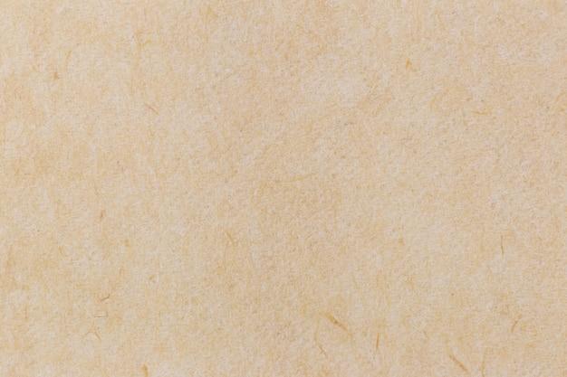 茶色のしわくちゃのリサイクル紙テクスチャ背景。