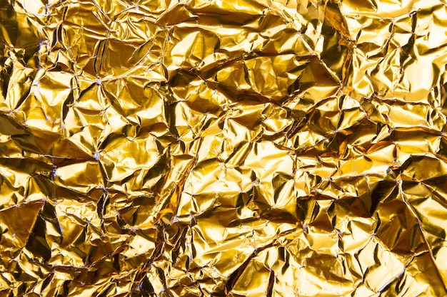 ゴールドのしわくちゃの箔紙テクスチャ