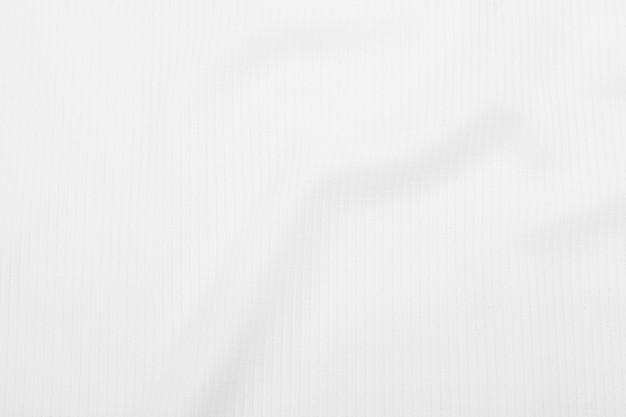 Белая предпосылка текстуры ткани с мягкими волнами.