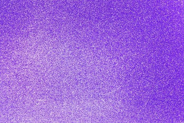 クリスマス、お祝いの概念の紫色のキラキラ光沢のあるテクスチャ背景。
