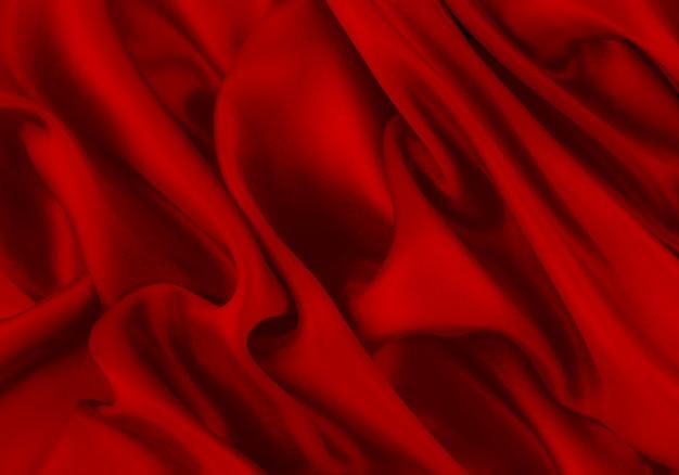 抽象的な背景の高級布または液体波または波状のひだ