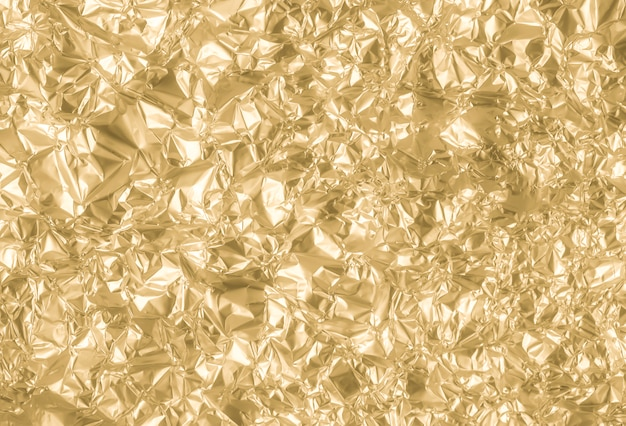 Золотой морщинистой бумаги текстуры абстрактный фон