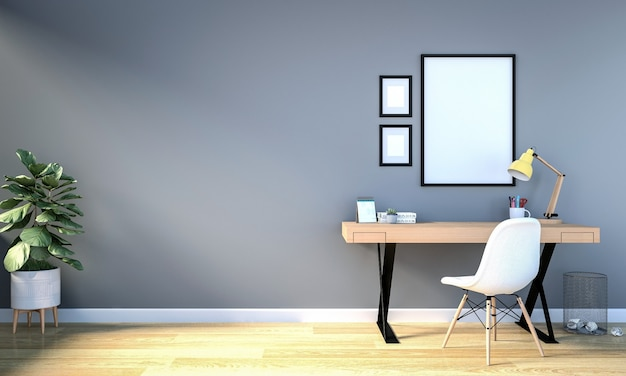 Интерьер рабочей комнаты с пустой фоторамкой для макета на стене