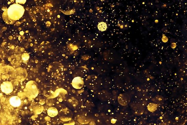 黄金の輝きボケ照明テクスチャ抽象的な背景をぼかした写真