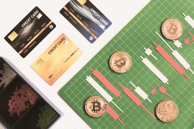 ローソク足チャートはクレジットカードでグリッド線とグリーンボード上のカラーペーパー白と赤から作る