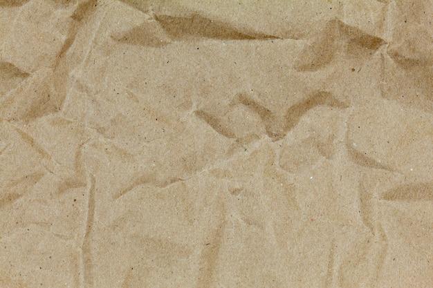 茶色のしわリサイクル紙のデザインと背景