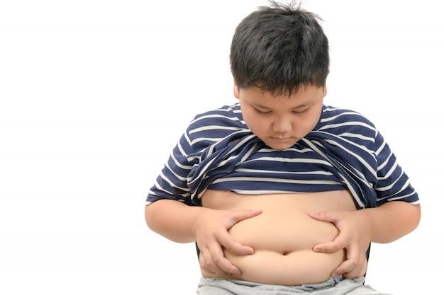 肥満太った少年の太りすぎ、白で隔離