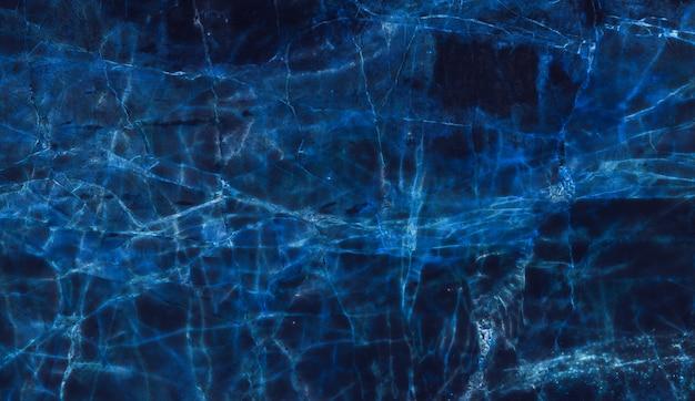背景の青の暗い大理石のテクスチャ
