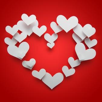 赤い背景の上の赤いハート形のバレンタインコンセプト