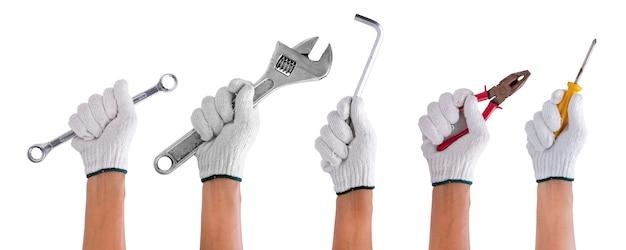 白で隔離ツール建設を持っている労働者の手のセット