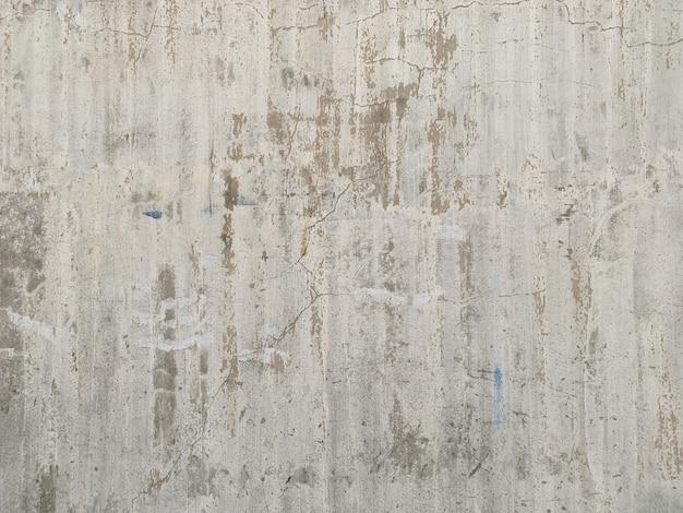 汚れた素朴な古いセメント壁を閉じる