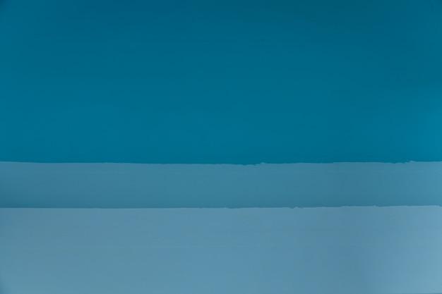 青色の壁の背景テクスチャ