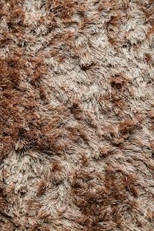 長いパイルのテクスチャの背景と茶色の布カーペット