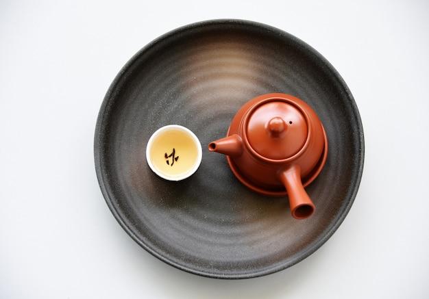 テーブル上の中国の茶の東洋の飲み物のスタイル、トップビュー、平らなレイ