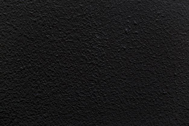 Черная пустая бетонная стена для фонового изображения.