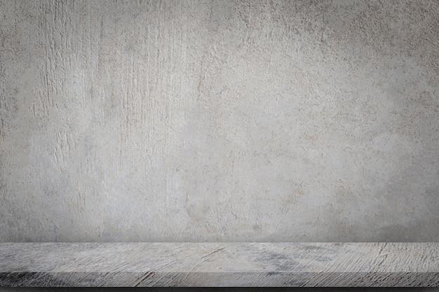 空の灰色のコンクリート壁の背景を持つコンクリートの床。