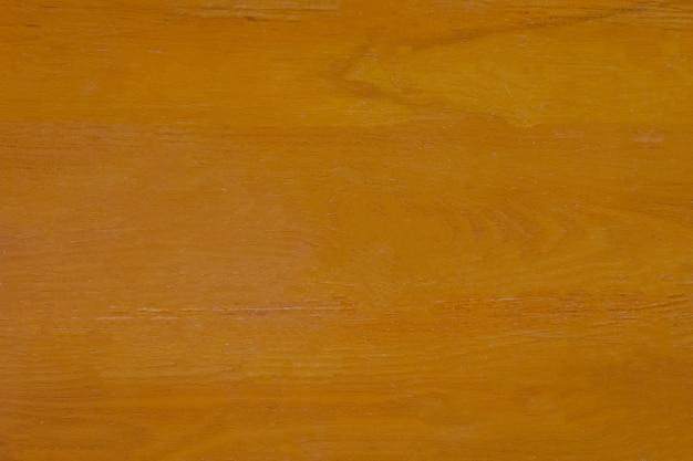 茶色の木のテーブル背景の平面図。
