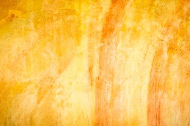 損傷のあるオレンジ色の漆喰壁。凹凸のある空のブリックウォール。