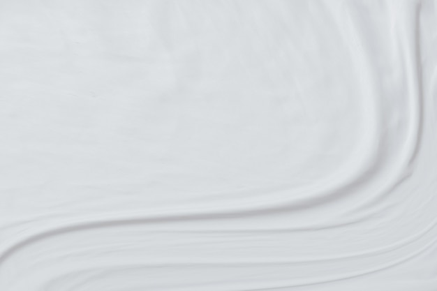 Конспект предпосылки белой ткани с мягкими волнами.