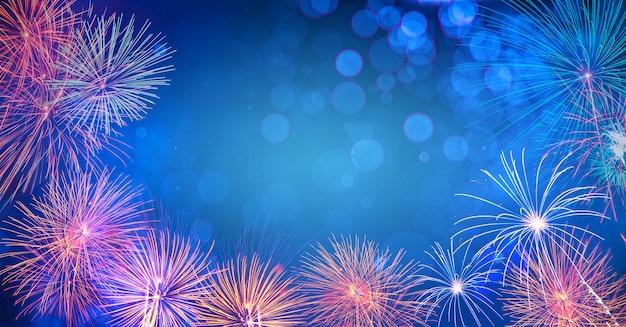 花火と抽象的な背景。新年の日のお祝いの背景多くのカラフルな