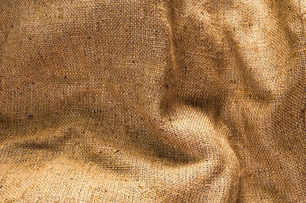 背景のビンテージベージュ生地のテクスチャ