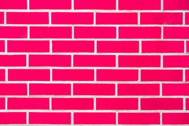 Насыщенная яркая современная розовая кирпичная стена