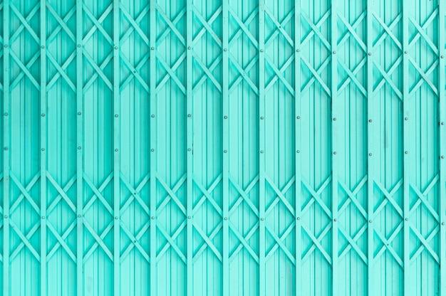 さびた金属、設計のための鋼鉄ドアのグランジレトロビンテージと古い緑の鋼鉄ドア鋼鉄ドア