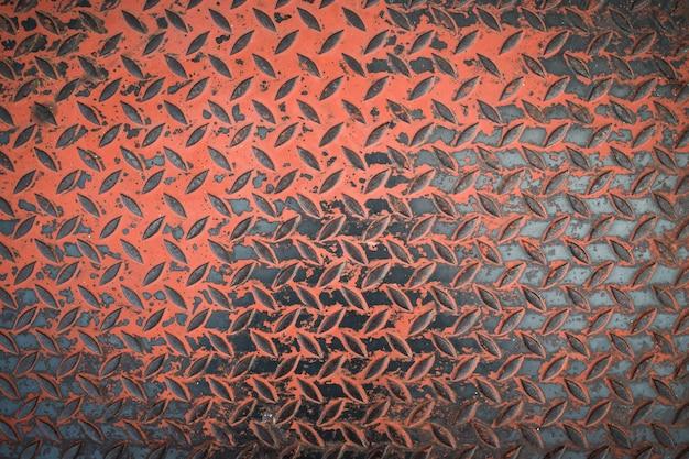 さびた鋼板テクスチャ背景。汚れた金属ダイヤモンドプレートの背景。