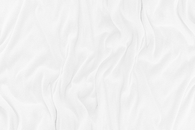 Текстура белой ткани с мягкими волнами. фон мятой ткани.