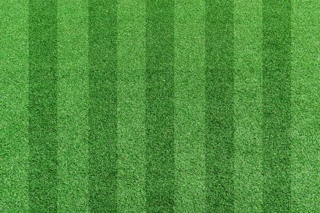 トップビューストライプ草サッカーフィールド。緑の芝生パターン背景