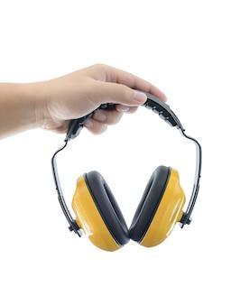 手を保護する保護ヘッドフォンを保持します
