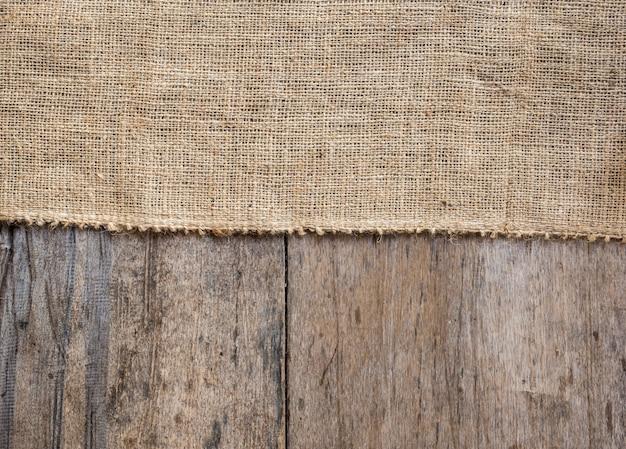 黄麻布と木製のテクスチャ背景