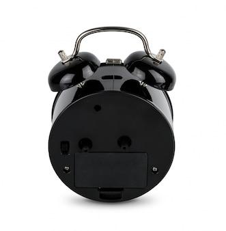 黒の目覚まし時計、白で隔離されるアナログツインベル