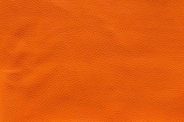 オレンジの革のテクスチャの背景