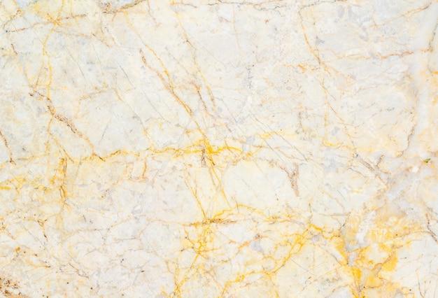 黄色の大理石の石の背景