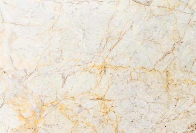 黄色のマーブル石のテクスチャ背景