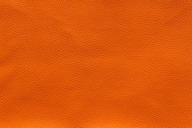 オレンジ色の革シートテクスチャのオレンジ色の背景