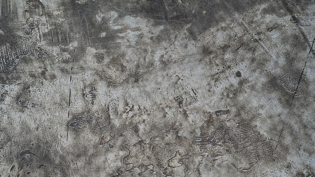 Конкретный деревенский пол с темной предпосылкой текстуры.
