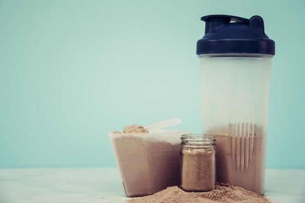 ダブルチョコレートホエープロテインパウダースクープ栄養健康食品ボディビル。