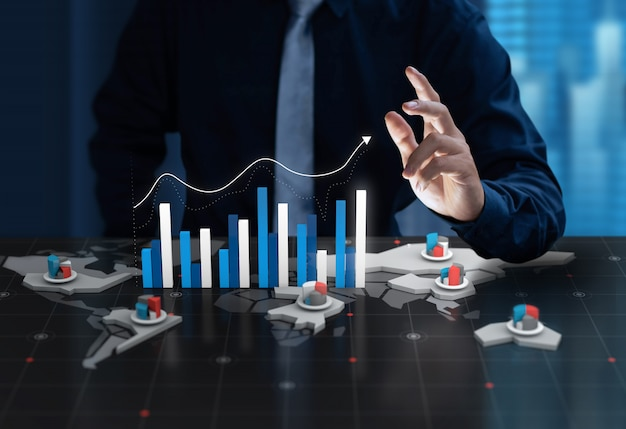 ビジネスマンは、デジタル世界地図画面でグラフの利益を表示