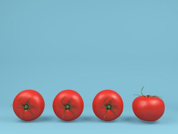 青いパステル調の背景に赤いトマト