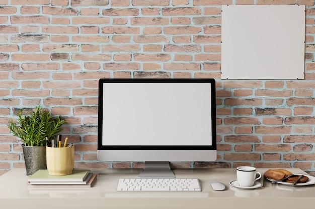白いラップトップ画面とコーヒーとテーブルの上の朝食のロフトワークスペース。