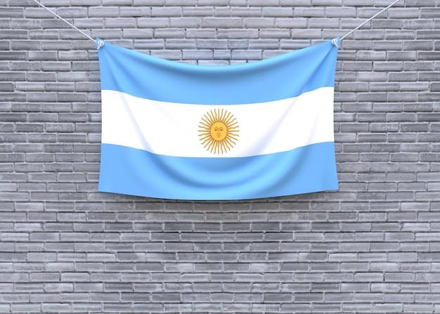 レンガの壁に掛かるアルゼンチンの国旗
